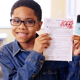 Student with graded worksheet