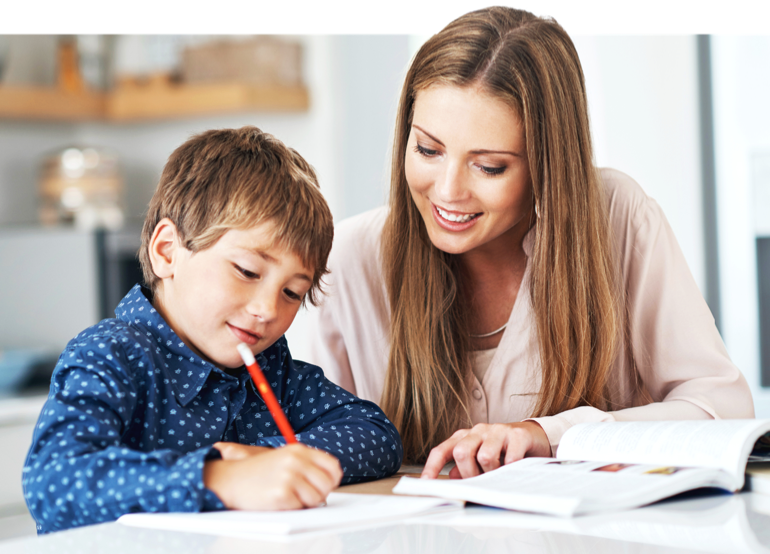 Mom excitedly helping her son complete his work