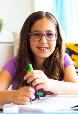 Girl happily using a compass tool